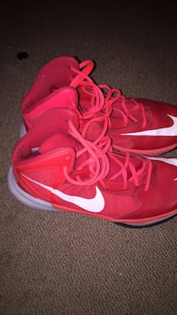 pair of red Nike basketball shoes null, V0K