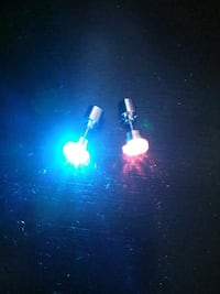 pair of silver-colored earrings with LED light