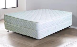 Full White Mattress - super comfy with box spring. New in Plastic. Pic for references