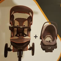 baby's black and red travel system Toronto, M6P 2T3