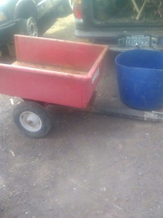 red wooden pull wagon