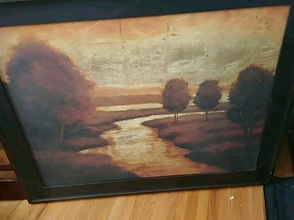 brown wooden framed painting of brown house