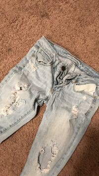 distressed blue denim jeans AMERICAN EAGLE