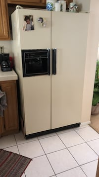 Side-by-side GE refrigerator With ice maker and water dispenser. available on the 21st Las Vegas, 89117