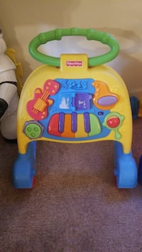green and white Fisher-Price learning walker