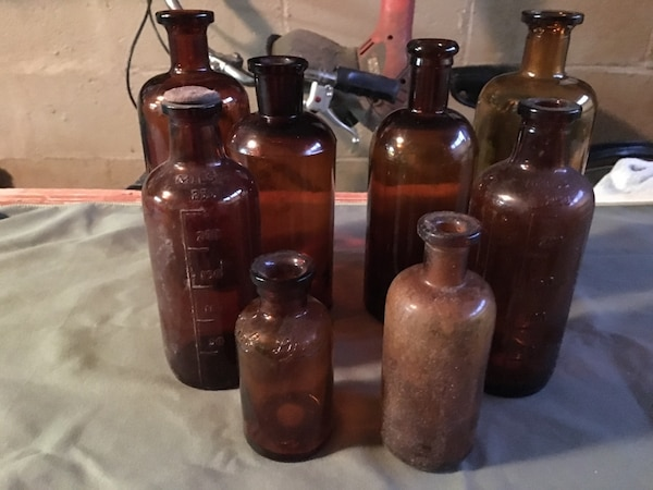 Eight antique amber apothecary bottles, various sizes. Price reduced for last time