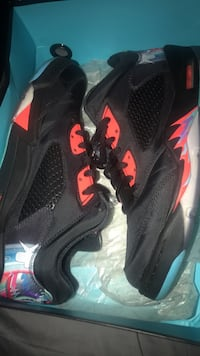 black-and-red Air Jordan 5 shoes with box