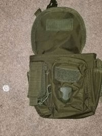 Tactical magazine holder and utility pouch. Military style