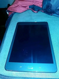 black tablet computer with blue case
