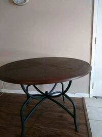 round brown wooden top table with black metal base Port Arthur, 77642