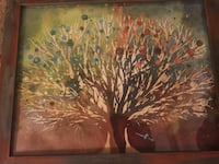 brown and blue flowering tree painting with brown wooden frame