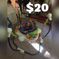 Baby's white, green, and blue Fisher-Price jumperoo 54 km