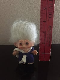 Highly collectible antique troll wearing a first aid uniform