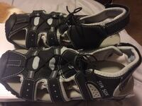 "BLACK AND GRAY/ S I Z E 7      SANDALS BY ""SEA SOX"".   BRAND NEW //  NEVER WORN  EXTREMELY COMFORTABLE.   PRICE LOWERED $6.00"