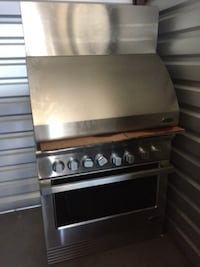 Grey stainless steel range oven and range hood