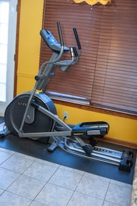 """LiveStrong SmoothStride 10.0E Elliptical with protective ¼"""" floor mat."""