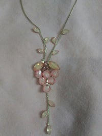 silver-colored gemstone studded necklace