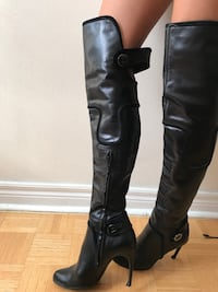 pair of black leather round-toe cork-heeled thigh-high boots