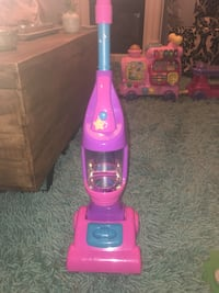 pink and purple Dirt Devil upright vacuum cleaner