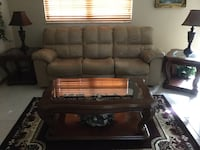 Leather sofa w/ recliners, swivel rocker recliner, two end tables, coffee table and lamps.  No rips or tears.  Tables do have wear and nicks and scratches.