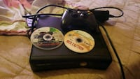 black Xbox 360 console with controller and game discs Corinth, 12822