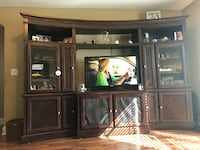 brown wooden TV hutch with flat screen television Warner Robins