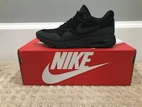 unpaired black Nike low-top sneaker with red box Richmond, V7C 1E4