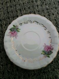 white and pink floral ceramic plate