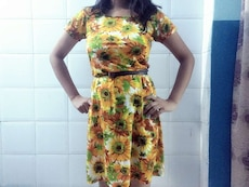 women's orange, white, and green floral scoop neck cap sleeve dress
