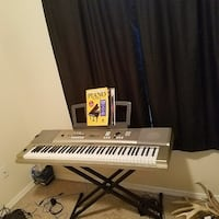 grey and white electronic keyboard
