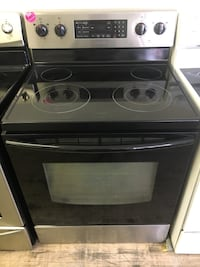 Samsung black and stainless steel electric stove Cleveland, 44109