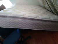 Rough looking but comfortable queen mattress with base