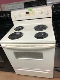 GE beige electric coil range stove  Woodbridge, 22191