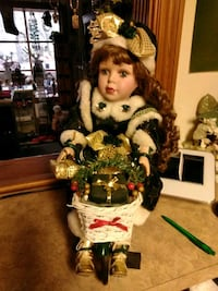 girl doll wearing green and white dress