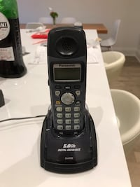 Black and gray panasonic wireless home phone