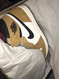 pair of white-and-brown Nike basketball shoes 48 km