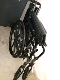 Wheelchair shower chair and bed