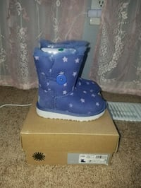 pair of blue UGG boots with box