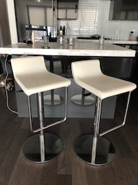 two white leather padded bar stools 535 km