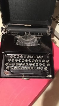 black and gray Corona typewriter with case Reston, 20194