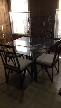 Glass table four chairs and wine and glass rack