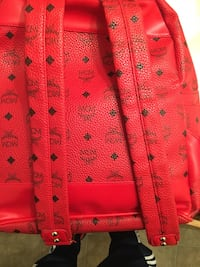 red MCM monogram leather backpack