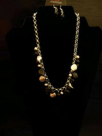 gold-colored and white beaded necklace 1198 mi