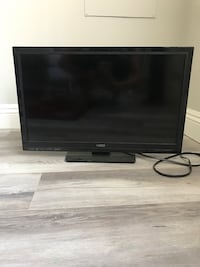 black flat screen TV with remote Glendale, 91204