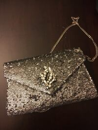 "Party purse, the middle ""diamond"" is missing... everything else is in perfect condition. Only used once. Guelph, N1L 0C7"