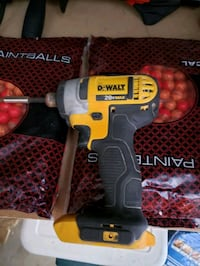black and yellow Dewalt cordless impact wrench