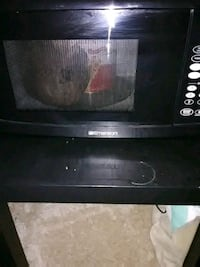 black Emerson brand microwave oven