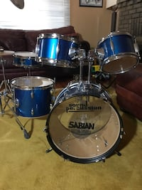 blue and white Pearl drum set