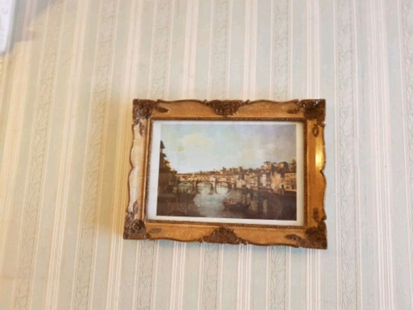 brown wooden framed wall paintings