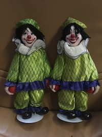 two green-and-white Clown ceramic figurines